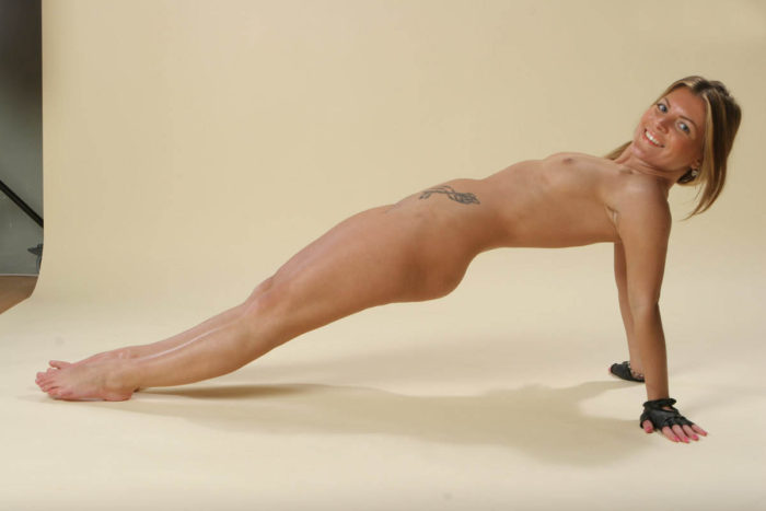Sporty blonde widely spreads her legs