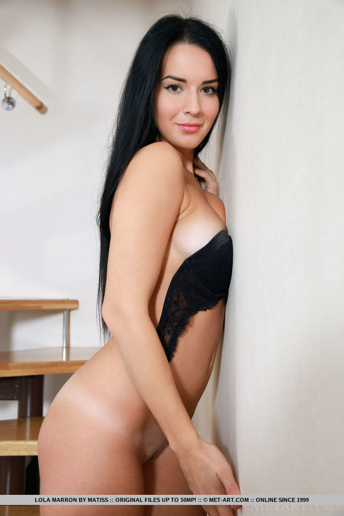 Sweet-smiling Lola Marron confidently poses in her matching black bra and panties