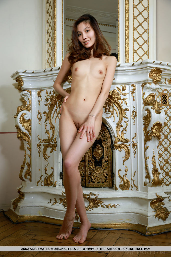 Anna Aki flaunts her slim body with small tits and smooth pussy in front of the camera.