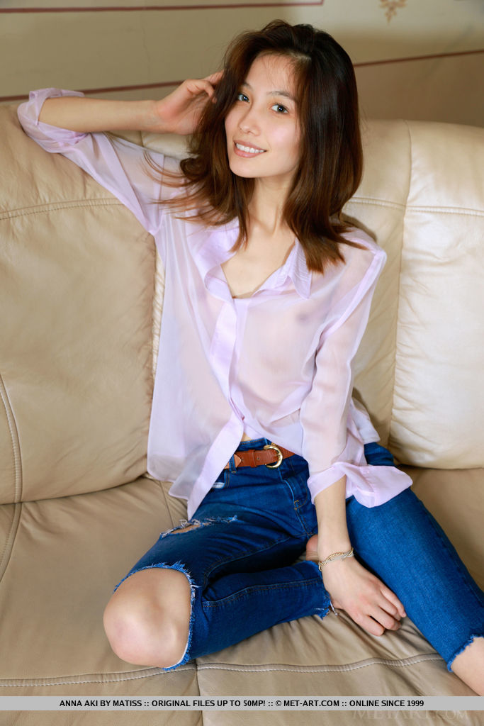 Anna Aki strip her long sleeves and jeans on the couch baring her slim body.