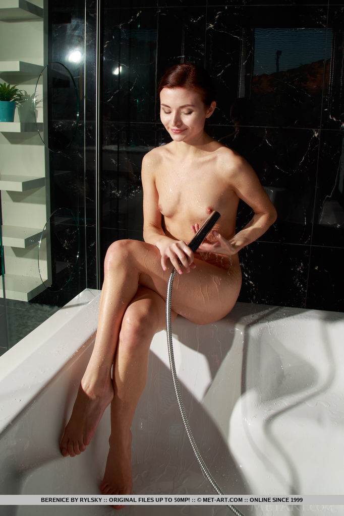 Berenice dips her tight body on the bathtub as she takes a shower.