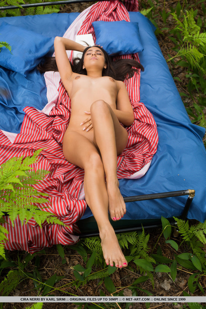 Cira Nerri poses in the forest baring her delectable, nubile body.