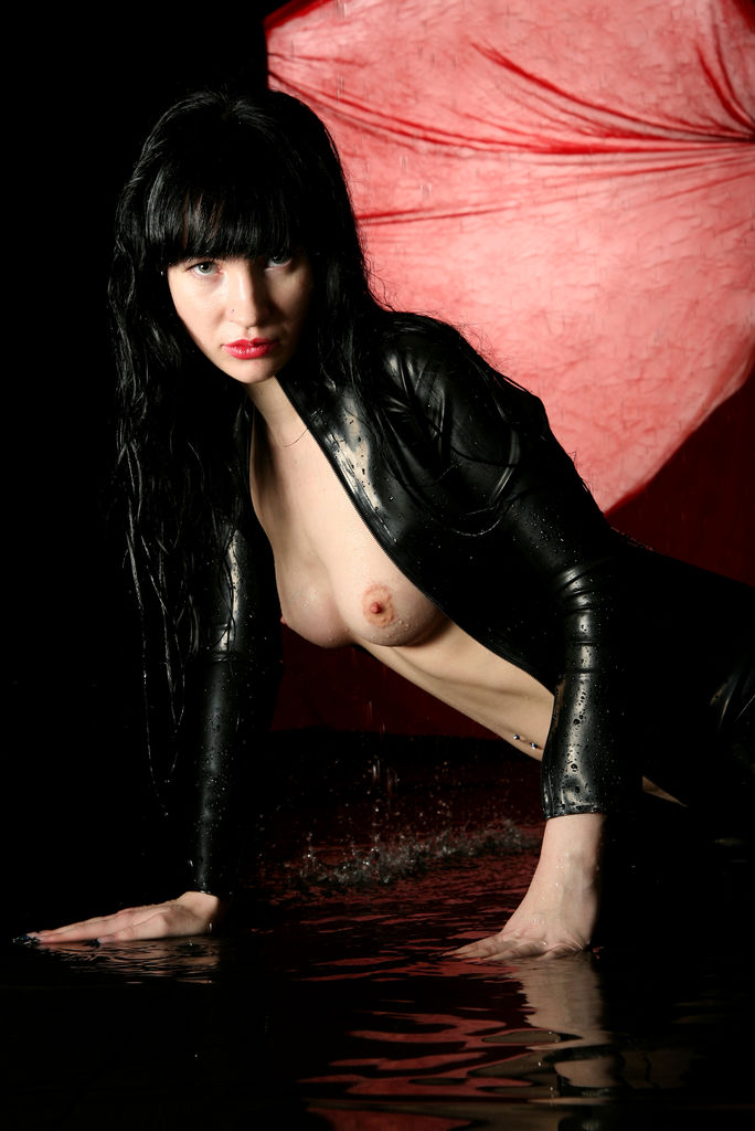 Ditta A strips her leather tights and jacket baring her yummy body.