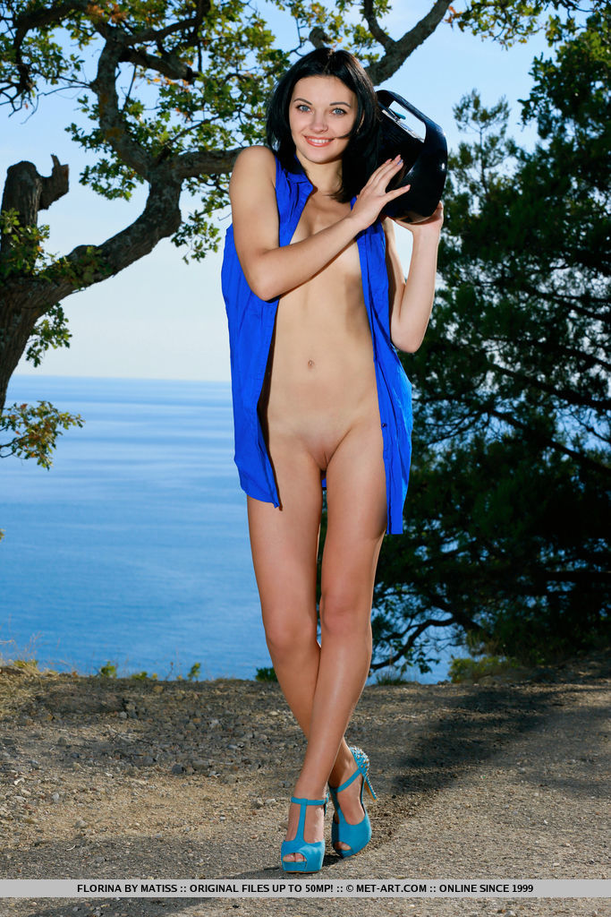 Florina bares her tight body and smooth pussy outdoors.