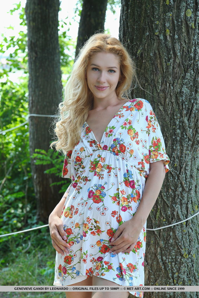 Gorgeous blonde Genevieve Gandi bares her delectable body by the tree.