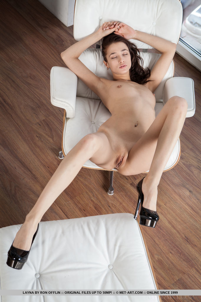 Layna shows off her petite, skinny body with small puffy breasts and long sexy legs in front of the camera.