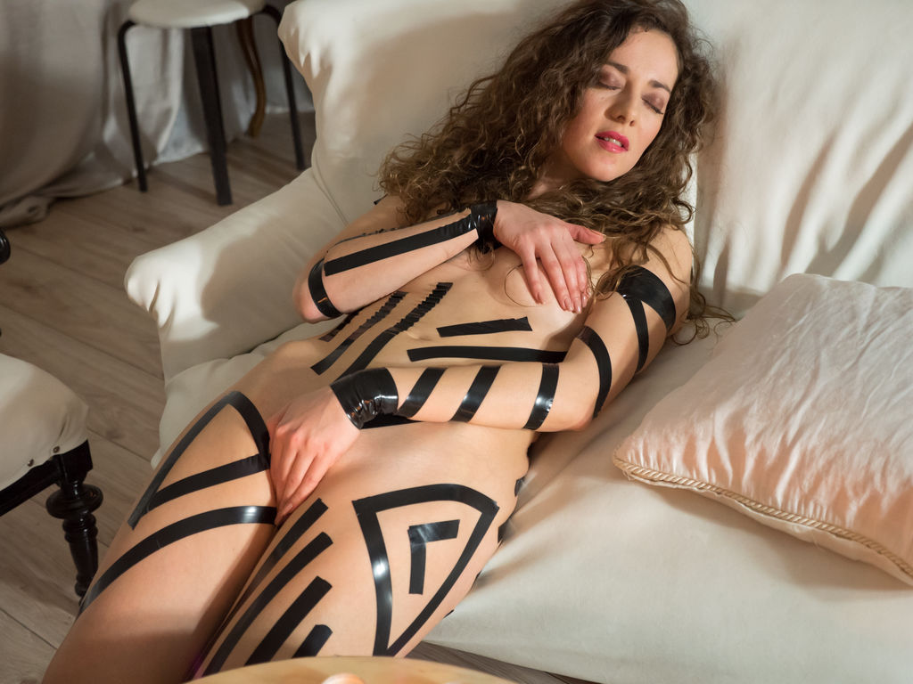 Louisa A displays her taped body and sweet pussy on the chair.