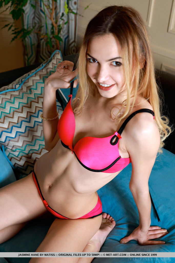 Newcomer Jasmine Hane strips on the couch baring her tight body.