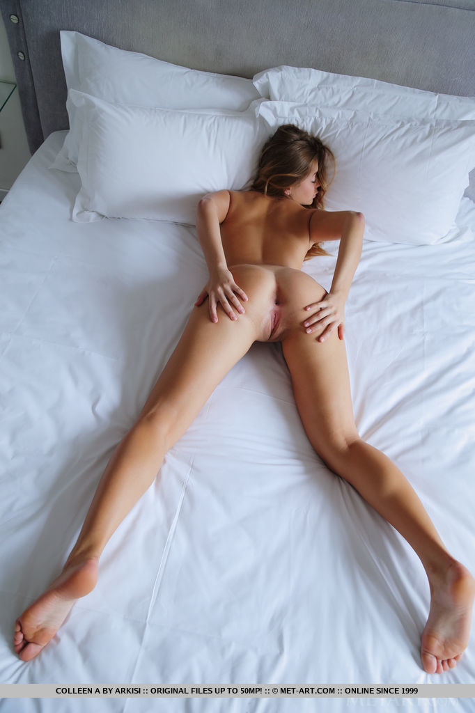 Petite and slender Colleen A gloriously naked and sprawled on the bed, baring her sweet and smooth assets with a charming smile.