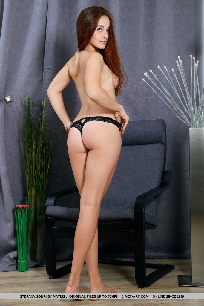 Stefany Sonri sensually poses on the chair baring her slender body.