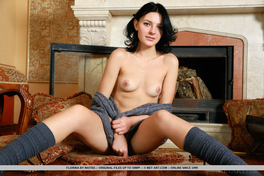 Top model Florina flaunts her delectable pussy on the floor.