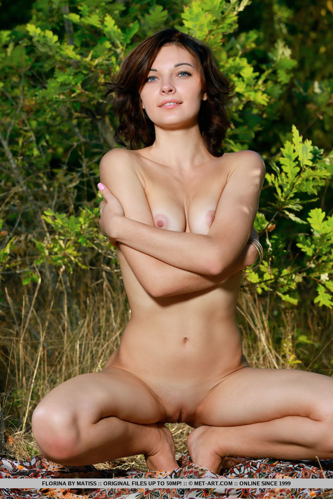 Top model Florina strips in the forest as she flaunts her nubile body.
