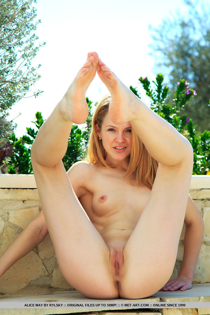 Alice May playfully poses outdoors baring her nubile body and pink pussy.
