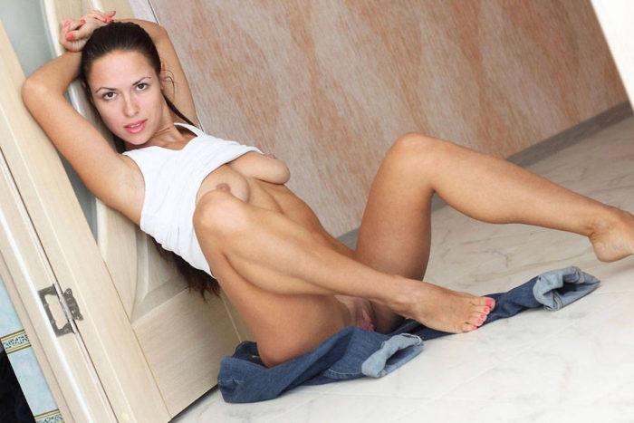 Amateur brunette Lina undressing at home