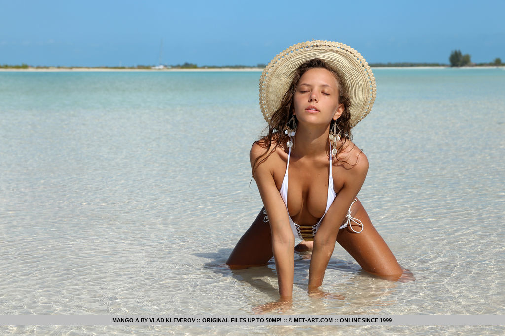 Beautiful Mango A strips her sexy one piece bikini as she shows off her sexy wet   body with erect nipples and tight ass in the beach.