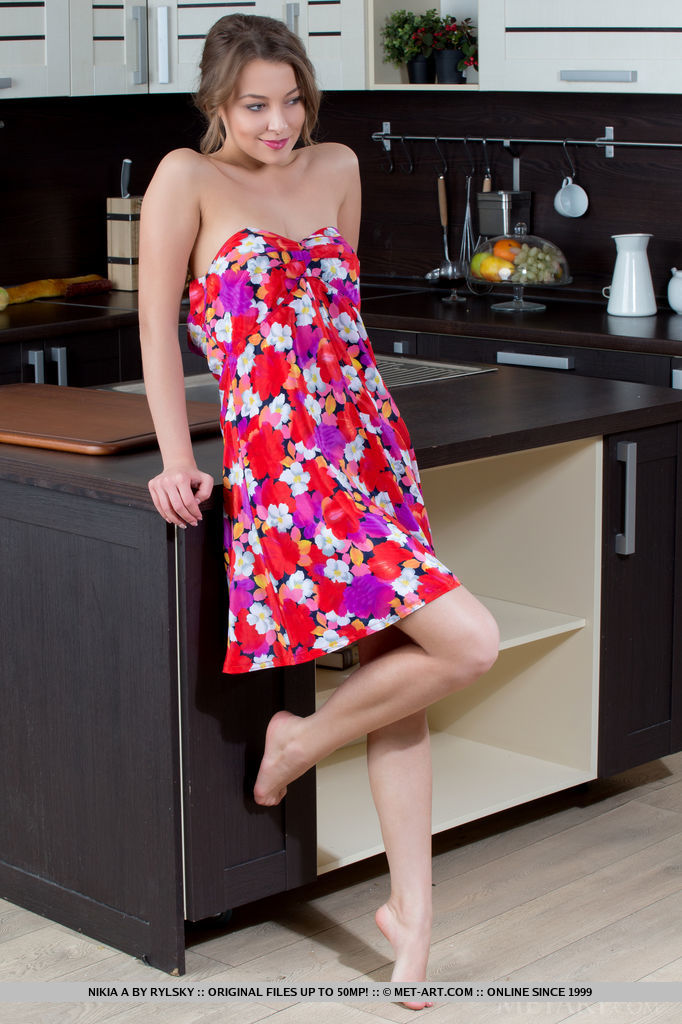 Beautiful Nikia A strips her flowery dress in the kitchen as she bares her nubile body   and delectable assets in front of the camera.