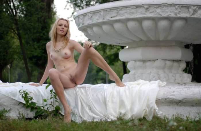 Beautiful blonde with sporty body at public park