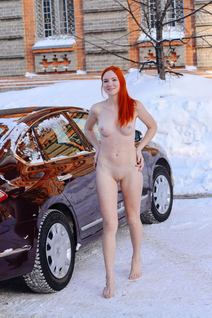 Bright-haired girl with hot body at winter streets