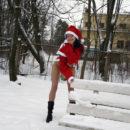 Brunette in Santa Clause dress at winter park