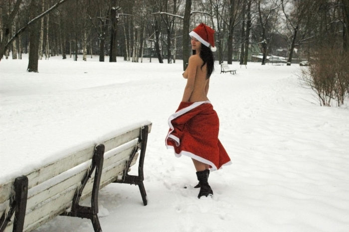 Brunette in Santa Clause dress at winter park