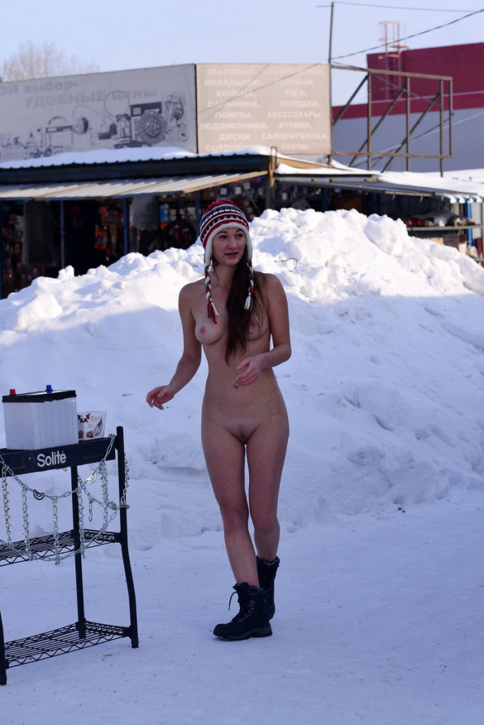 Crazy russian girl posing naked at winter market