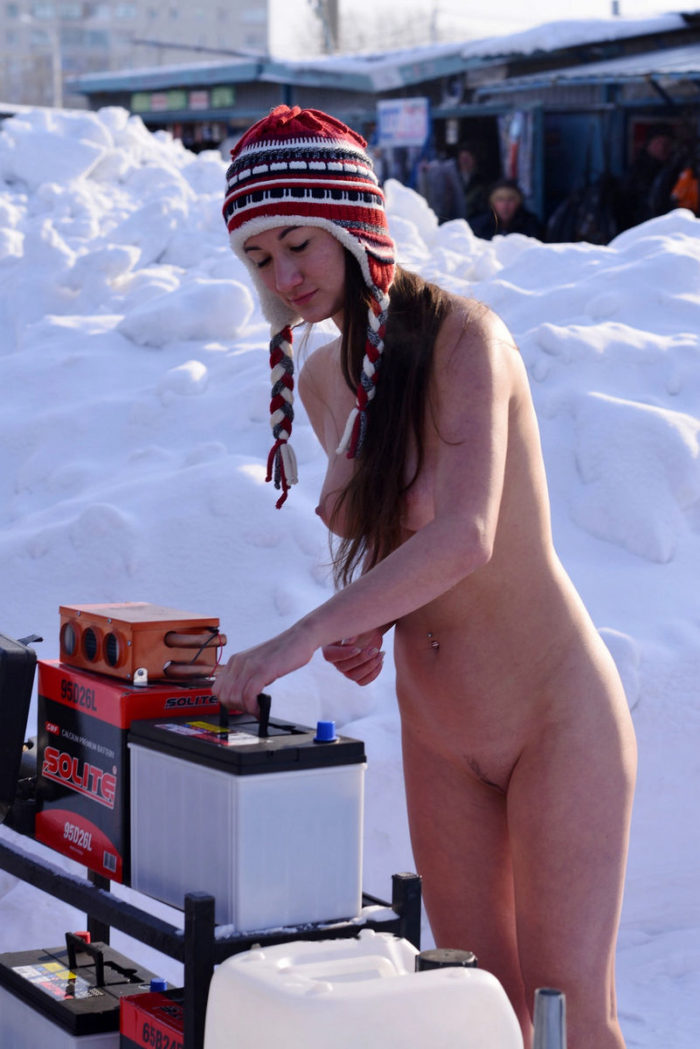 Crazy russian girl posing naked at winter market