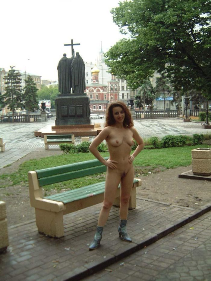Curly girl walks in boots at Moscow streets