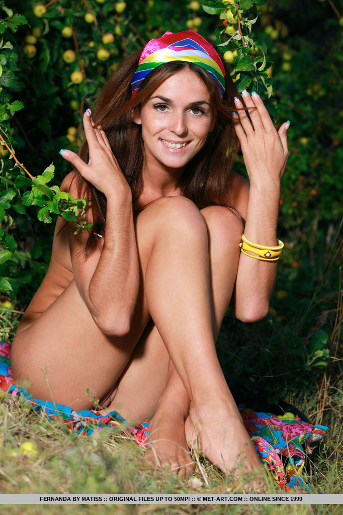 Fernanda strisp her colorful bikini revealing her sexy body as delightfully poses in the outdoors.