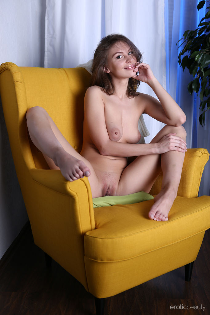 Galina A strips on the chair baring her sexy body and sweet pussy.