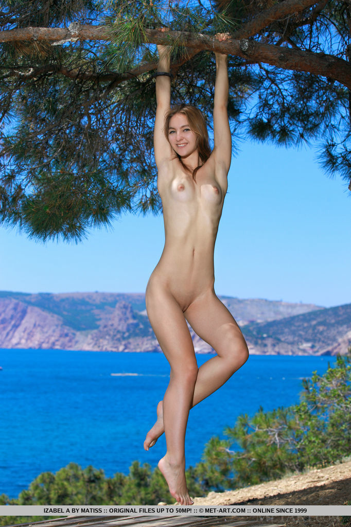 Izabel A looks charming and sweet in the outdoors with her youthful appeal, long and slender physique, and endearing smile.