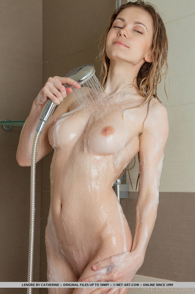 Lenore displays her delectable body with beautiful breasts and pink puffy nipples under the shower of water.