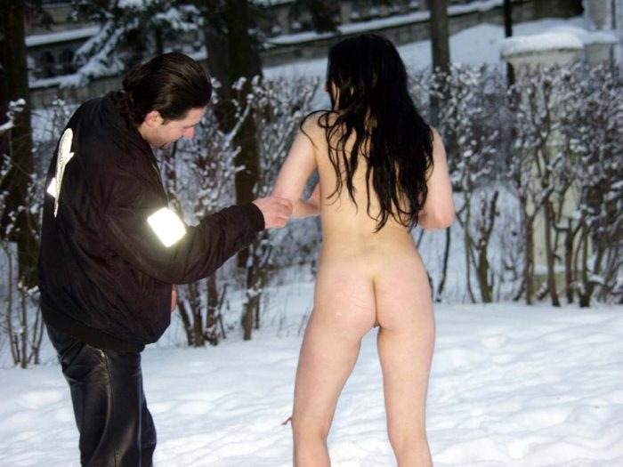 Naked brunette posing at winter park