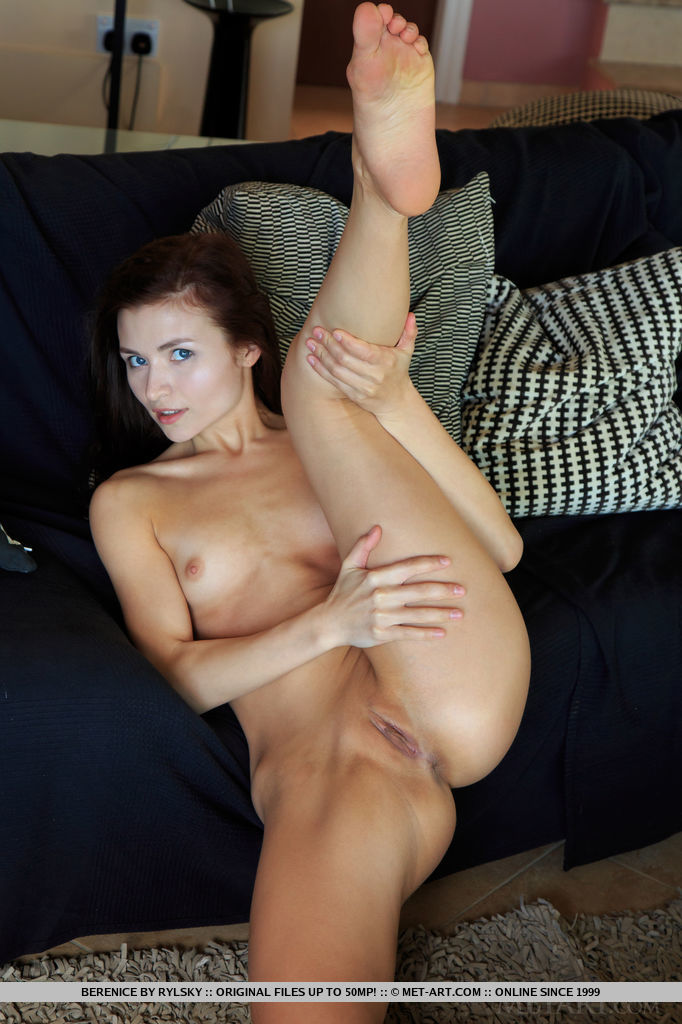 Redhead Berenice spreads her legs wide open baring her sweet pussy.