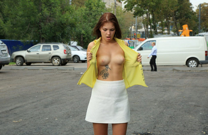 Redhead russian girl flashes her tits and pussy at streets