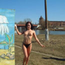 Redheaded hottie walks naked at city beach