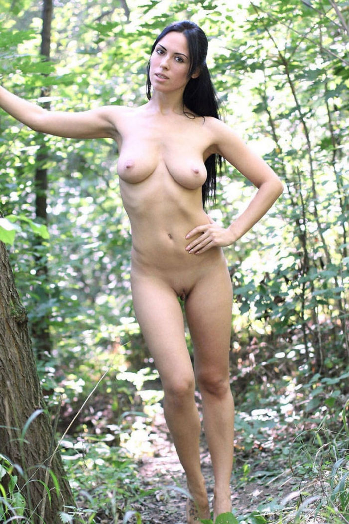 Russian amateur girl posing in the woods