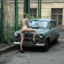 Russian teen on an old car