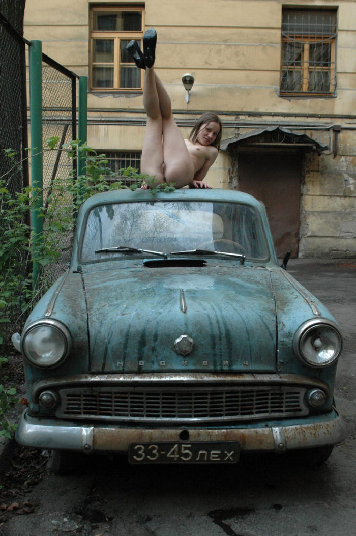 Russian teen on an old car