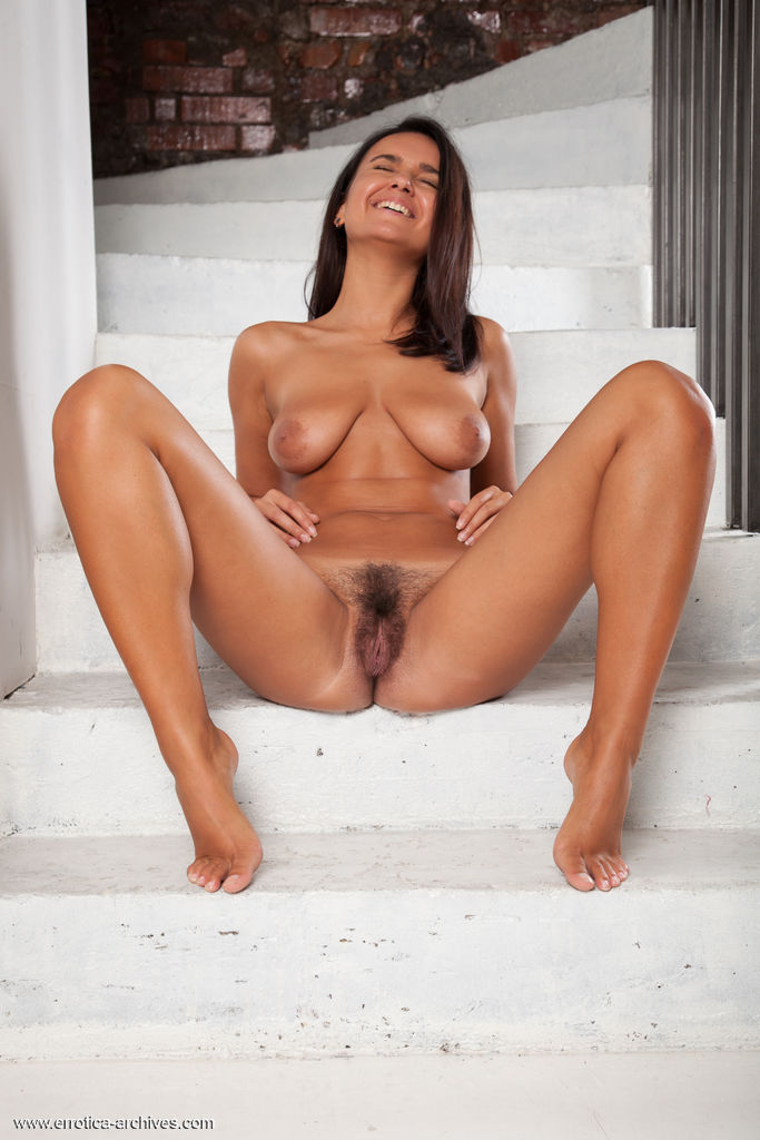 Sanita Bares Her Gorgeous Tits And Hairy Pussy On The Stairs