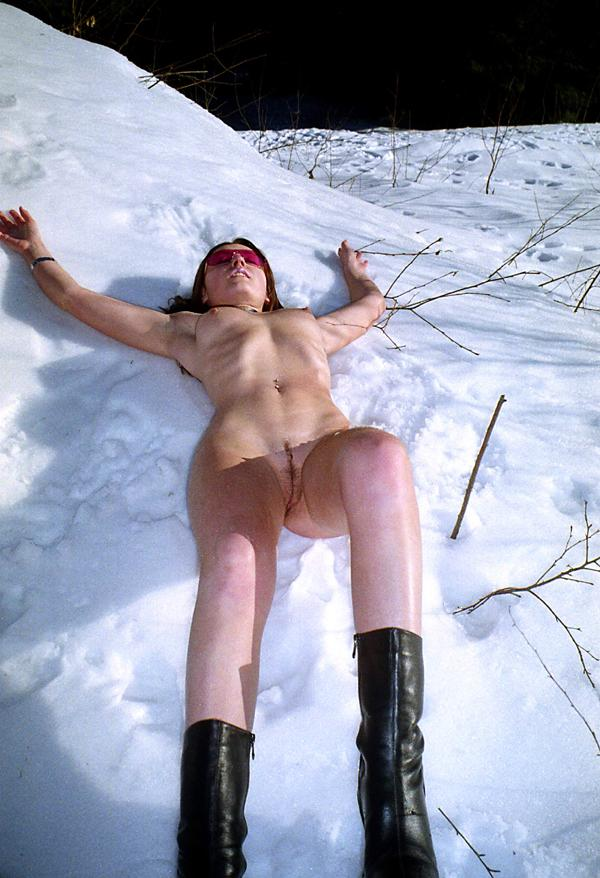 Sexy girl Jella takes off black panties at winter forest