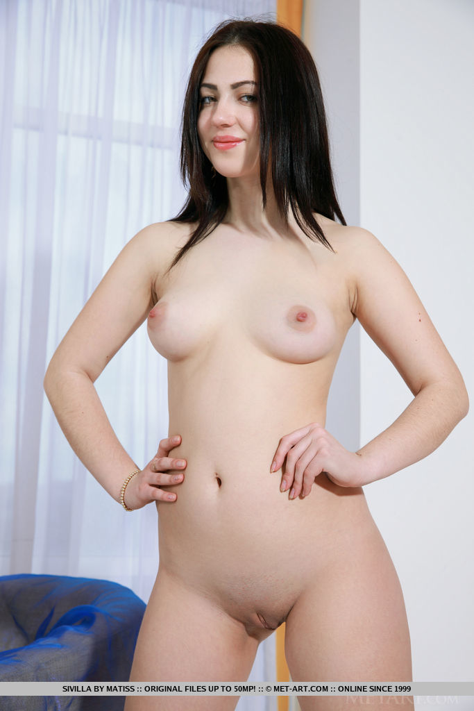 Sivilla strip her sexy lingerie baring her delectable body on the chair.