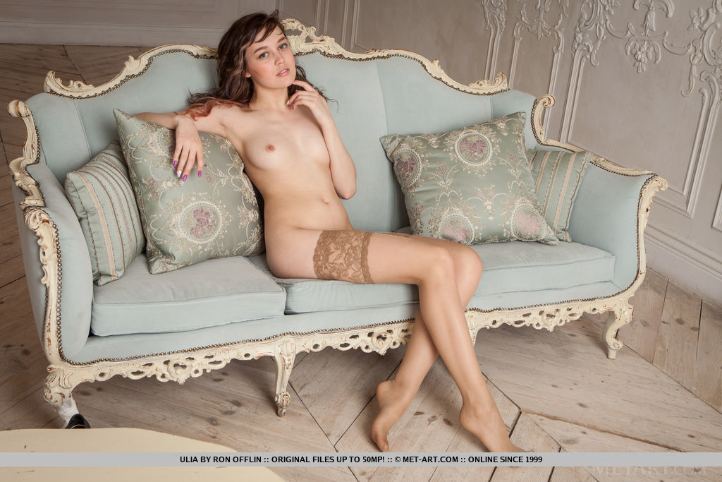 Ulia spreads her wide open baring her hairy pussy on the chair.