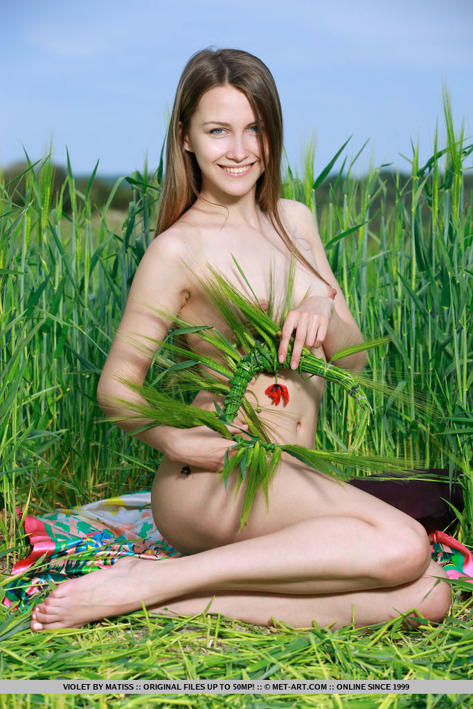 Violet spread her legs on the grassy field baring her delectable pussy.