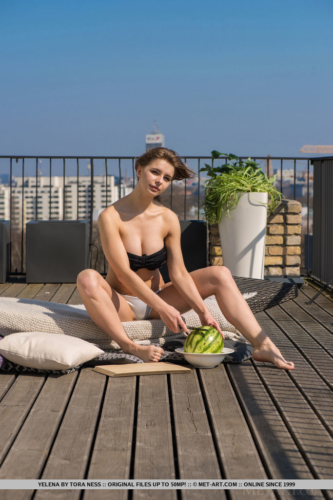 Yelena shows off her luscious body with large tits as she eats watermelon.