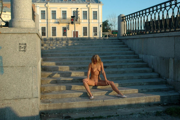 Blonde Nataly S shows all her sweet holes on the street stairs
