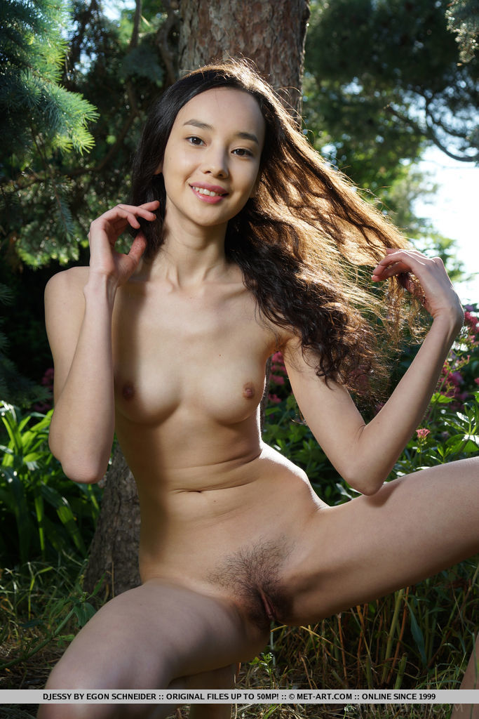 Djessy bares her petite body and trimmed pussy outdoors.