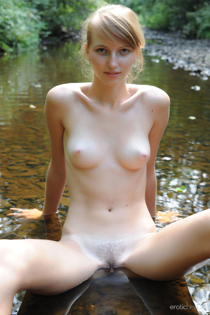 Eriska A strips in the outdoors as she fluants her smooth, nubile body in front of the camera.