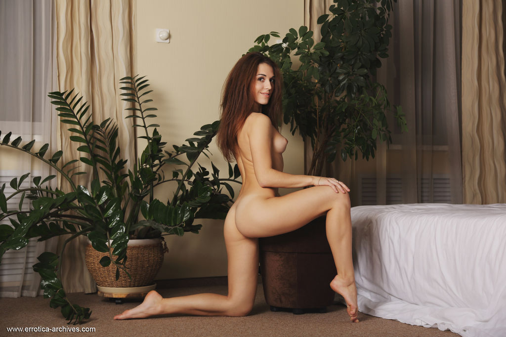 Eva Kane flaunt her slender physique and tight ass as she poses uninhibited by the bed.