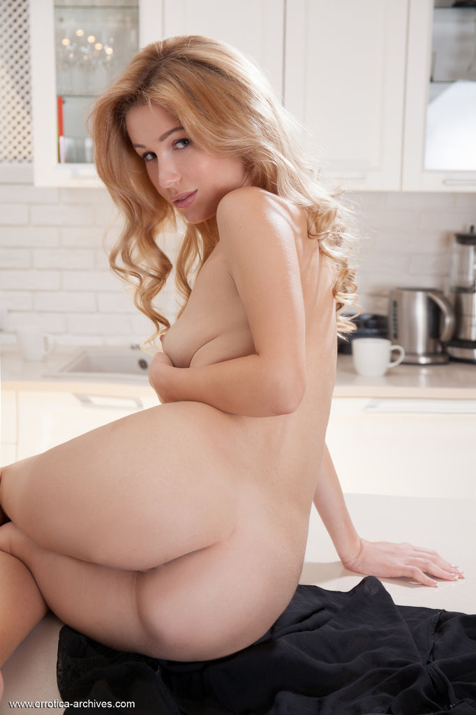 Genevieve Gandi bares her delectable body and sweet pussy in the kitchen.