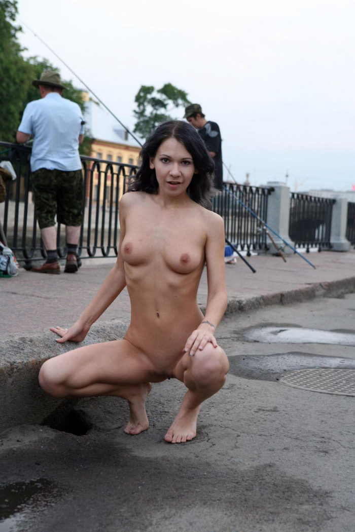 Naked girl walks next to the fishermen